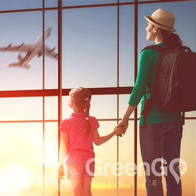 galapagos-cruises-for-families - Woman holding childs hand as they watch plane takeoff
