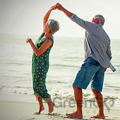 galapagos-cruises-for-families - elderly couple dancing on the beach