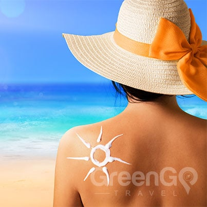Galapagos-Packing-List-Girl-with-sunscreen-on-her-back-shaped-like-a-sun