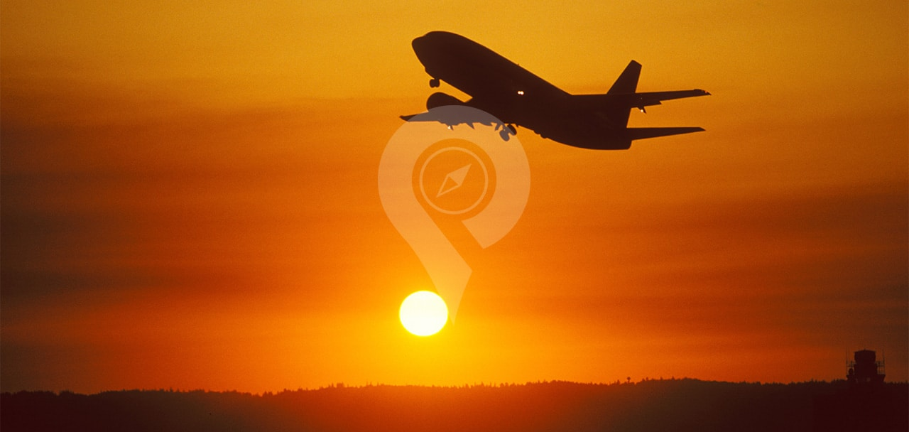 Mary-anne-galapagos-cruise-airfare-Plane-flying-in-orange-sky