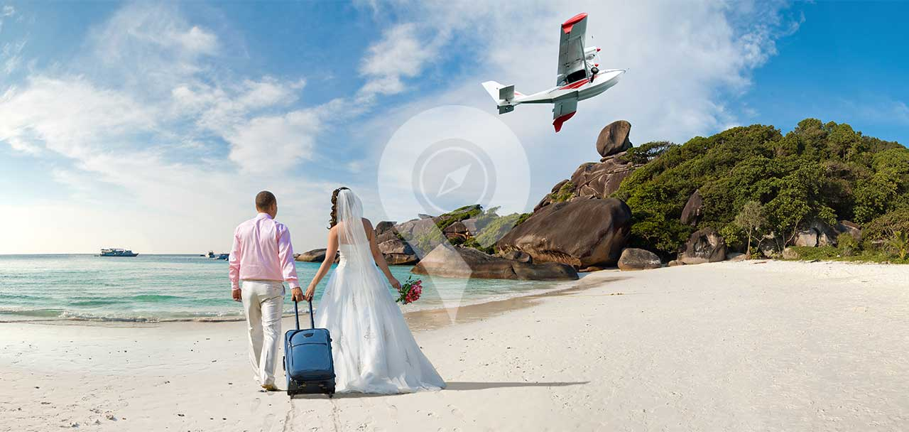 Sea-Star-Galapagos-Cruise-Honeymoon-Packages-Couple-holding-hands-on-the-beach-in-Galapagos-with-plane-flying-overhead