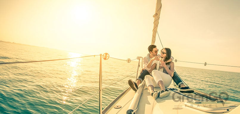 Tip-Top-V-Galapagos-Cruise-Honeymoon-Experience-Honeymoon-CoupleSitting-on-Sailboat